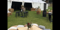 Festoon lighting wine barrells, dry bars